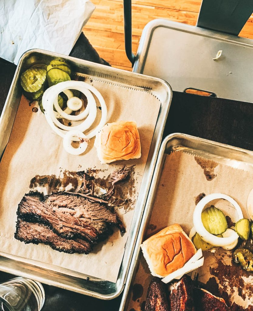 Brisket and pickles on tray