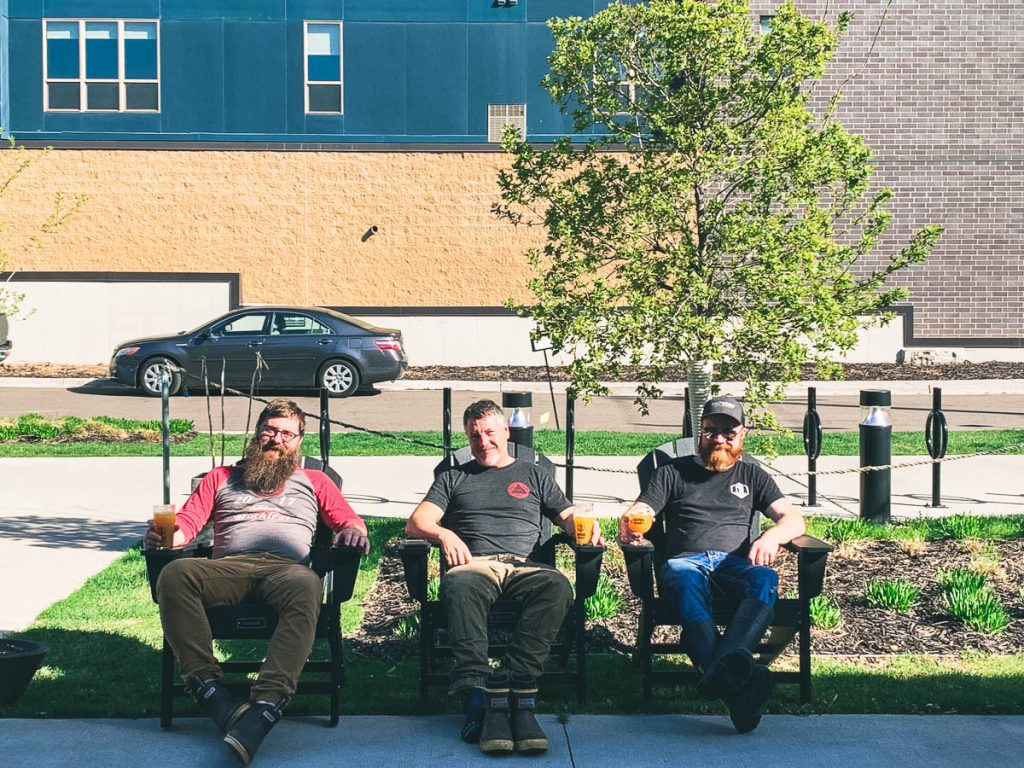 Men sitting on patio with beers